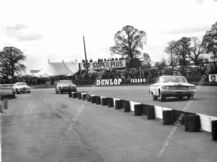 FORD GALAXIE Jack Sears, Wilment car leads Jaguars. Suilverstone 1963